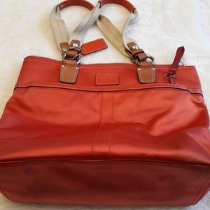 Stained satiny orange tan Coach purse